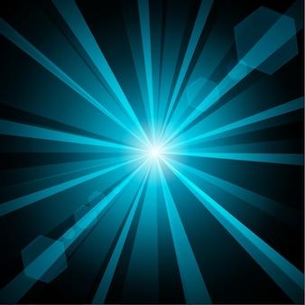暗い背景にレンズのフレアがある青い輝き