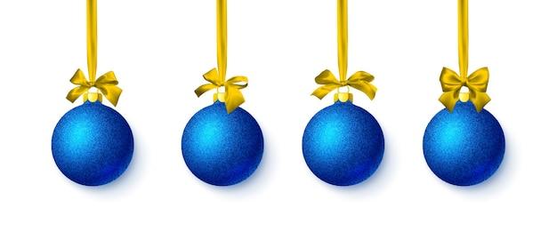 黄色の弓と青い光沢のあるキラキラ輝くクリスマスボール