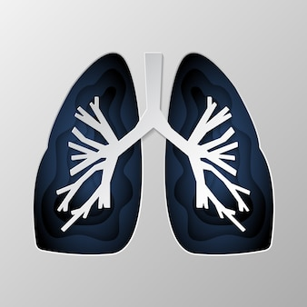 Blue silhouette of the lungs carved on paper.
