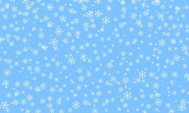 Blue snow background. falling white snowflakes.