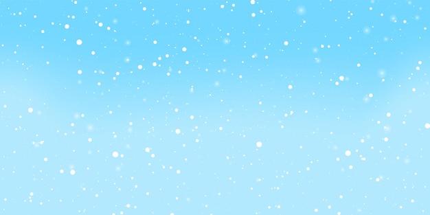 Blue snow background. winter sky. white snowflakes.