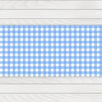 Blue tablecloth on white wood table
