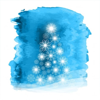 Blue watercolor background with christmas tree made of bright snowflakes