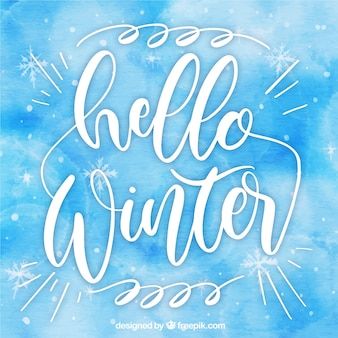 Blue watercolour background hello winter with lettering