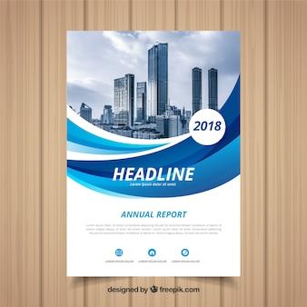 이미지와 함께 푸른 물결 모양의 연례 보고서 표지