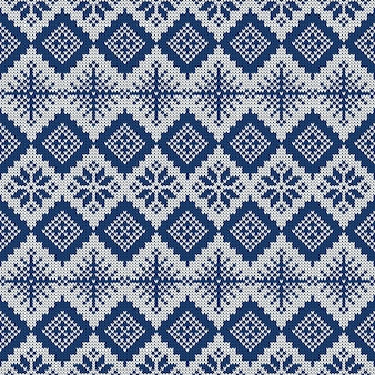 Blue and white knitted seamless pattern with snowflakes and traditional scandinavian ornament.
