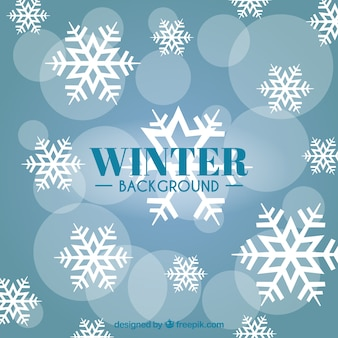 Sfondo blu witter con fiocchi di neve