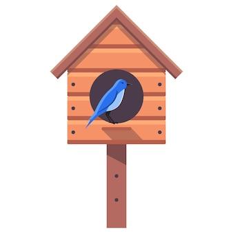 ブルーバードは新しい木製の巣箱に座っています。