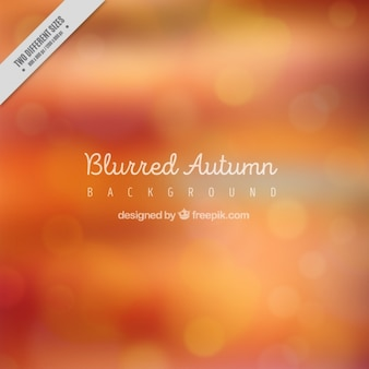 Blurred autumn background in orange tones