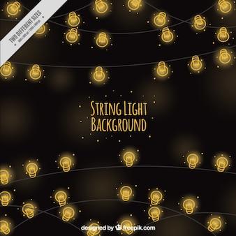 Sfondo sfocato di disegnati a mano luci stringa