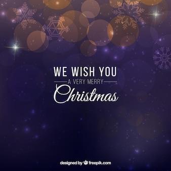 배경을 흐리게 우리는 당신에게 메리 크리스마스를 기원합니다