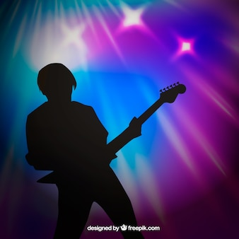 Blurred background with guitar player silhouette