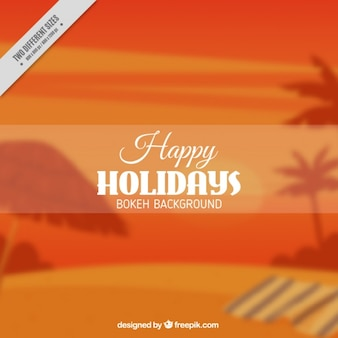 Blurred background with palm trees in orange tones