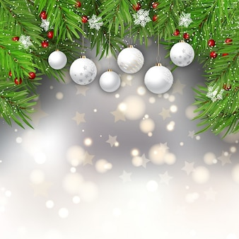 Blurred bokeh background with christmas balls and spruce leaves
