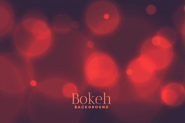 Blurred bokeh light effect background in faded red color