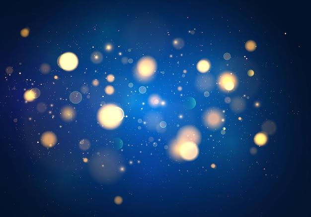 ダークブルーの背景にボケ味の光がぼやけています。抽象的なキラキラが点滅する星と火花の焦点をぼかしました。
