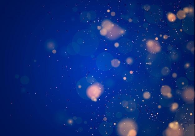 暗い青色の背景にぼけボケライト。と新年の休日テンプレート。抽象的なキラキラデフォーカス点滅星と火花。