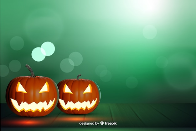 Blurred green background with carved pumpkins