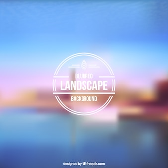 Blurred landscape with retro badge