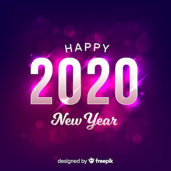 Blurred new year 2020 on gradient violet