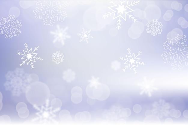 冬の背景にぼやけた雪片
