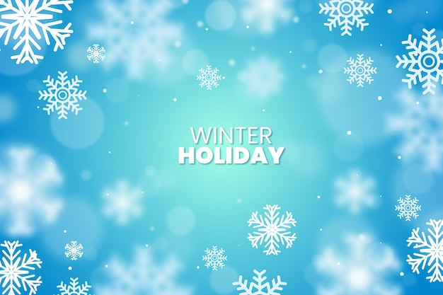 Blurred snowflakes with winter text background