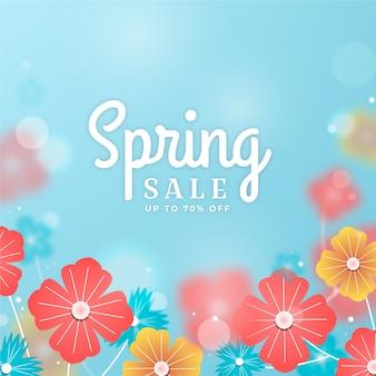 Размытое изображение весенней распродажи с цветами и надписью