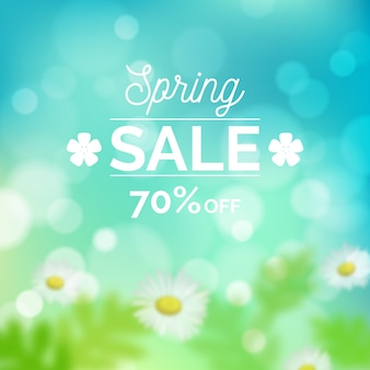 Blurred spring sale with daisies