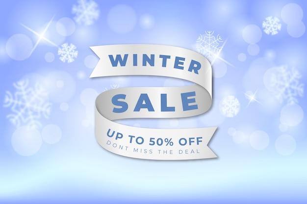 Blurred winter sale concept with ribbon