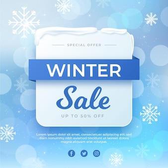 Blurred winter sale with snowflakes