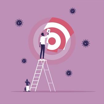 明確な焦点または焦点を絞った目的のためのビジネスの比喩としてビジネスマンによって掃除されているぼやけたターゲット