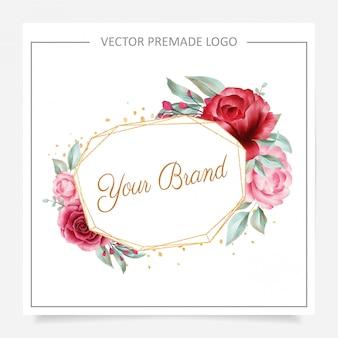 結婚式やブランディング用にあらかじめ作られた赤面とバーガンディの幾何学的な花のロゴ