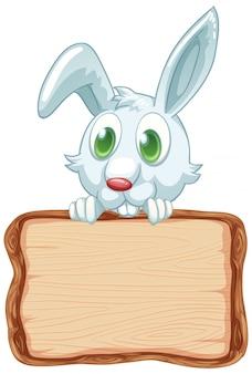 白い背景の上のかわいいウサギとボードテンプレート