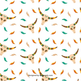 Boho pattern with feathers and skulls