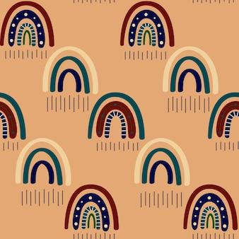 自由奔放に生きる虹のシームレスなパターン。トレンディな温かみのあるゴールデン、ブラウン、イエローの色調のレインボーボヘミアン。テキスタイル、紙、プリントデザインのモダンなベクトルイラスト