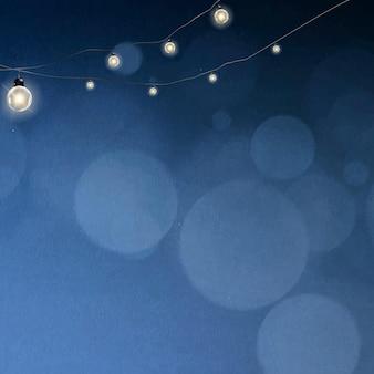 Sfondo bokeh in blu con luci sospese incandescenti