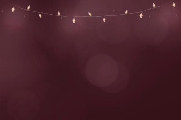 Vettore di sfondo bokeh in rosso bordeaux con luci appese incandescenti