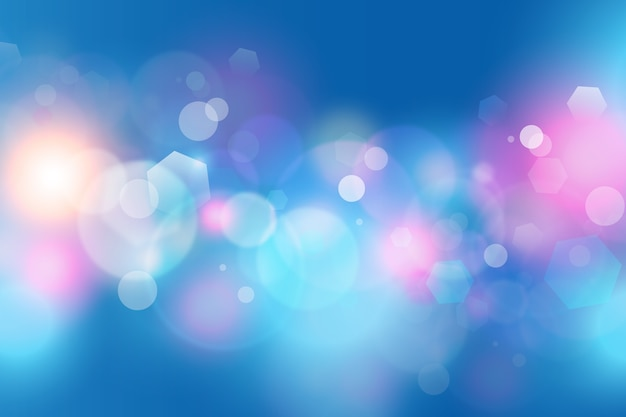 Bokeh background with sparkles of dust in cold colours
