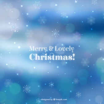 Bokeh blue christmas background of snowflakes