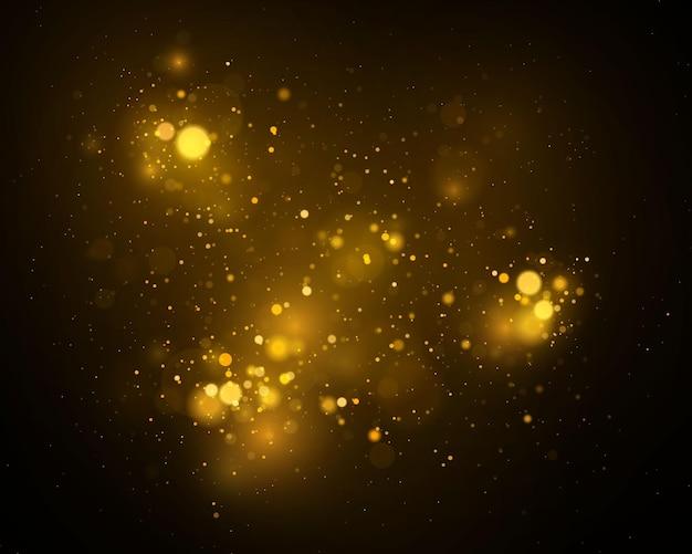 ボケ効果。きらめく魔法の金黄色のほこりの粒子。魔法の黄金の概念。抽象的な黒い背景