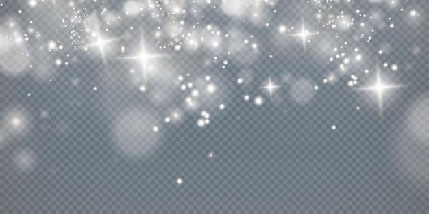 ボケ光の光が背景に影響を与える輝くほこりのクリスマスの背景クリスマスの輝く光