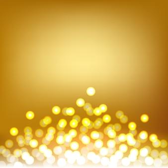 ゴールドbokehとライト抽象的な背景