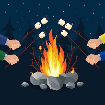 焚き火とマシュマロのロースト。夜のキャンプファイヤー