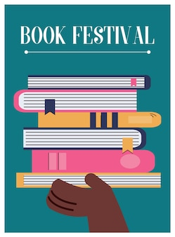 本のスタックを手に持ってブックフェスティバルのポスター