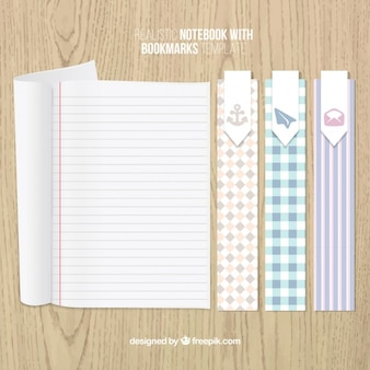 Book markers and a striped notebook