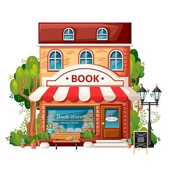 Книжный магазин вид спереди. элементы города. . книжный магазин с приветственной вывеской, скамейкой, фонарем, зелеными кустами и деревьями. иллюстрация на белом фоне.