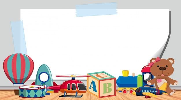 床にたくさんのおもちゃがある枠線テンプレート