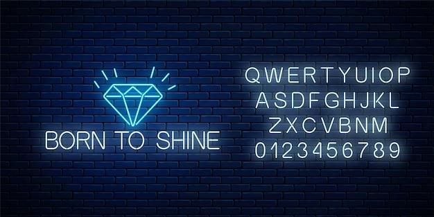 Рожденный сиять светящийся неоновый знак с сияющим бриллиантом на темной кирпичной стене с алфавитом.