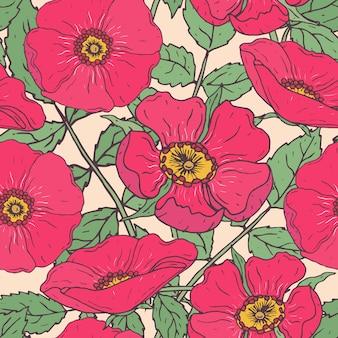 ピンクの犬のバラ、緑の茎と葉を持つ植物のシームレスなパターン。ビンテージスタイルで描かれた美しい庭の花手。包装紙、テキスタイルプリント、壁紙の花のイラスト。