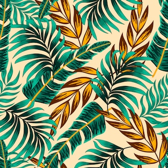 Botanical seamless tropical pattern with bright plants and leaves on a beige background